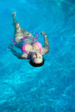 Happy girl relaxing in pool Royalty Free Stock Photos