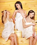 Happy girl relaxing in sauna. Royalty Free Stock Photography