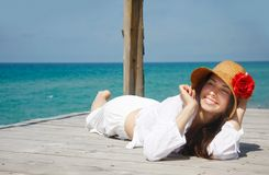 Happy girl relaxing on sea background Stock Photos