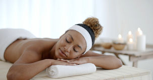 Happy Girl Relaxing In Spa Salon. Happy african american girl relaxing in luxury spa salon Royalty Free Stock Photography