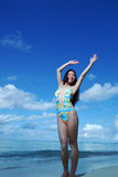 Happy girl relaxing on tropical beach Stock Photography