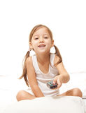 Happy girl  with a remote control Royalty Free Stock Photography