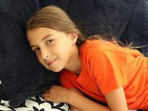 Happy Girl Resting on Comfortable Pillows royalty free stock images