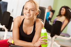 Happy girl resting at the gym Stock Photo