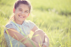 Happy girl resting at sunny meadow Royalty Free Stock Images