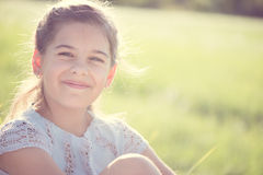 Happy girl resting at sunny meadow Royalty Free Stock Photography