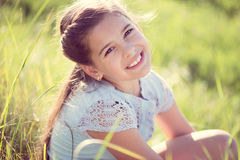 Happy girl resting at sunny meadow Stock Photos