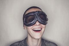 Happy girl in retro pilot glasses over grey Royalty Free Stock Images