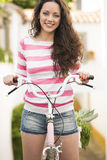 Happy girl riding a bicycle Royalty Free Stock Image