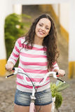 Happy girl riding a bicycle Stock Images