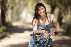Happy girl riding a bicycle Royalty Free Stock Photo