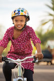 Happy Girl Riding Bike Stock Image