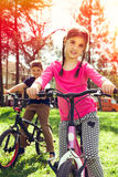 Happy girl riding a bike Royalty Free Stock Photos