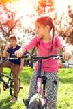 Happy girl riding a bike Stock Photo