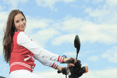 Happy girl riding scooter enjoy summer vacation Stock Images