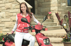 Happy girl riding scooter enjoy summer vacation Stock Photo