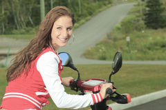 Happy girl riding scooter enjoy summer vacation Royalty Free Stock Image