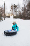 Happy girl riding on a sled   mountain high Stock Image