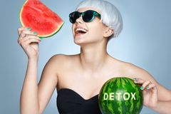 Happy girl with ripe watermelon. stock photos
