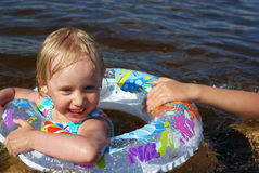 Happy girl in the river. Happy girl with rubber ring plays in the river Royalty Free Stock Photography