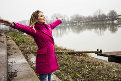 Young Happy Girl and river Royalty Free Stock Photography