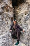 Happy girl in a rock crevice Stock Images