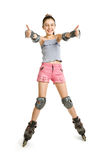 The happy girl on rollers. Shows thumbs of hands upwards Royalty Free Stock Image