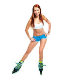Happy girl with rollerskates Stock Photography