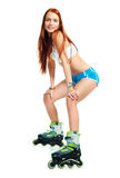 Happy girl with rollerskates Royalty Free Stock Images