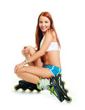 Happy girl with rollerskates Stock Photos