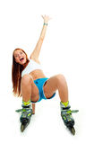 Happy girl with rollerskates Stock Images