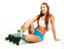 Happy girl with rollerskates Royalty Free Stock Photo