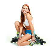 Happy girl with rollerskates Royalty Free Stock Image