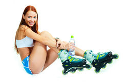 Happy girl with rollerskates Stock Image