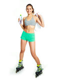 Happy girl with rollerskates drinking water Stock Photo