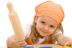 Happy girl with a rolling pin Royalty Free Stock Photo