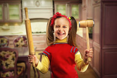 Happy girl with rolling-pin Stock Images