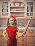 Happy girl with rolling-pin Royalty Free Stock Image