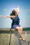 Happy girl on roof summer day Royalty Free Stock Image