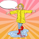 Happy Girl in Rubbers Running on Puddles after Rain Royalty Free Stock Photo