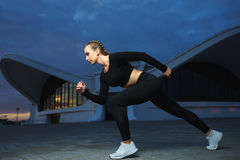 Happy girl run outdoor at modern urban area during sunset. Stock Images