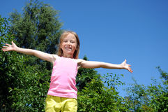 Happy girl run in park Royalty Free Stock Photo