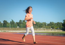 Happy girl run Stock Image