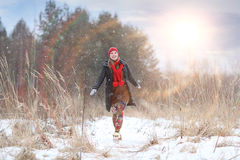 Happy girl run in winter  forest Royalty Free Stock Images