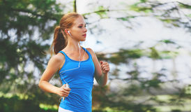 Happy girl runner in for sports and fitness runs in summer in pa stock photo