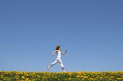 Happy girl running Stock Photos