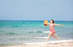 Happy girl running on beach Stock Image