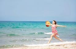 Happy girl running on beach Stock Image