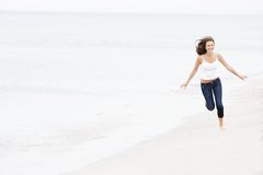 Happy girl running on beach Royalty Free Stock Photos
