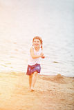 Happy girl running on beach in summer Royalty Free Stock Images
